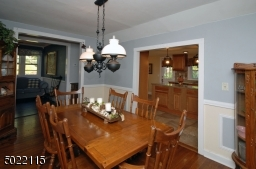 Large Formal Dining Room with Wainscoating and Crown Molding