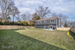 Completely fenced-in, you can play worry free in this spacious backyard that offers plenty of room for adding playground equipment, playing badminton and more.