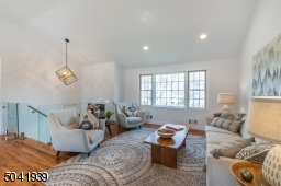 Bright and airy yet intimate, the living room is part of an open concept design, and blends effortlessly into the dining room creating a great space for entertaining.