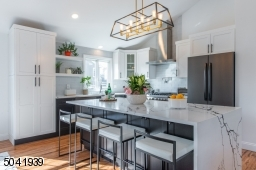 Designed with the discerning gourmet in mind, this stylish modern kitchen comes outfitted with sleek cabinetry, a spectacular quartz center island and professional grade appliances. Don?t be surprised when guests keep coming back to the kitchen!