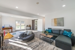 Casual meets modern comfort in this spacious family room that boasts a fabulous spa bath, laundry room and sliding glass doors that lead to an outdoor patio and a sprawling yard.