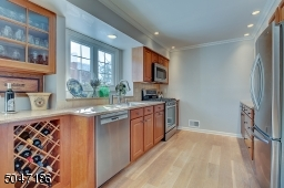 Renovated Kitchen featuring custom cabinets, wine bar and quartz counters.
