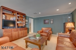 Cozy Family Room with built in custom cabinetry for entertainment center.
