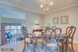 Formal Dining Room with crown molding and pantry/china closet.