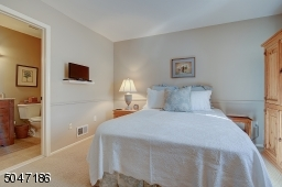 en suite bedroom and California closet system in closet.