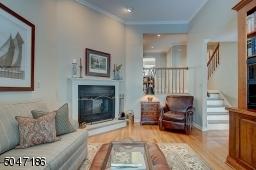 Woodburning Fireplace, Hardwood floors and crown molding.