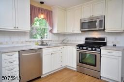 Flooring in kitchen is laminate wood