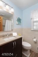 Renovated 3 yrs ago with stone sink, porcelain tiles