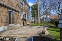 Sliders off the family room take you out to the Paver patio