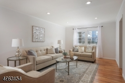 Sunlit living room with newly refinished floors, rec. lighting, insulated windows