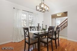 Formal Dinning Room with modern light fixture, sparkling wood floors