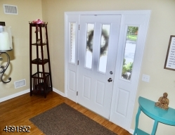 Entry Foyer with Gorgeous Bamboo Flooring and double closet