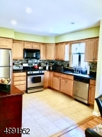 With SS Appliances and Granite Countertops