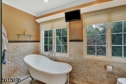 The master bath as observed from the opposing perspective.