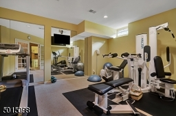The home's fully-finished, lower level offers a fabulous, nicely-equipped gym. It's all there for you ~ one simply has to use it.