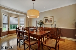 The formal dining room offers pinpoint recessed illumination and could easily seat twelve or more adults.