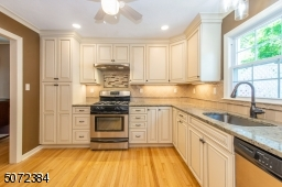 Renovated Kitchen with white cabinets, quartz counters & tons of storage