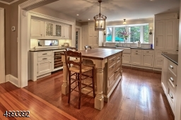 Designer Kitchen by Canterbury, La Cornue stove, pot filler, 2 Sub-Zero refrigerators with freezer drawers, wine cooler, expansive islandView from Kitchen to Dining Room