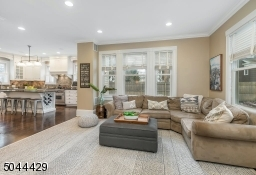 Family Room Opens To Kitchen