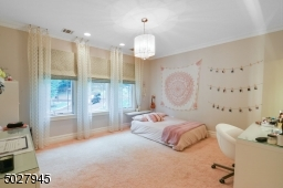 15' x 15' Recessed lighting, chandelier, walk-in closet with custom closet system, wall to wall carpet, en suite bath custom vanity with marble countertop, tumbled marble floor to ceiling shower, dark and light emperador marble tile floor