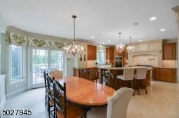 """24"""" Travertine Tile Floor, Slider to elevated deck, open floor plan to Great Room"""