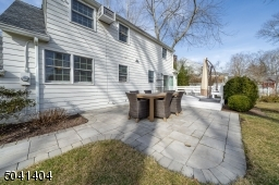 Custom Stone walkway from front of home to Patio, Deck and Back yard
