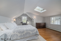 Natural Light with hardwoods. Room for Exercise bike or desk and more.