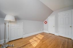 Second Floor Bedroom with multiple windows, hardwoods and built in storage.