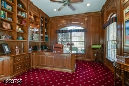 Custom cherry wood office with build in desk and bookcases