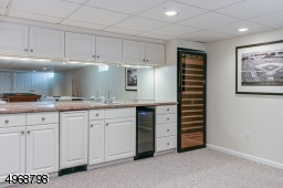 Wet bar with two wine refrigerators