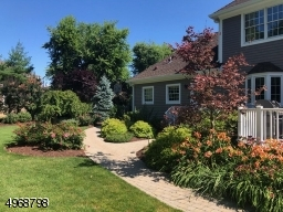 Backyard is fully landscaped with flowers blooming from Spring thru Fall!  Sprinkler System - front & backyards