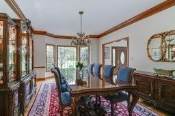 Grand room with custom moldings, hard wood floor and bay window