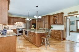 Custom Cherry wood cabinetry, custom sink and pot filler faucet