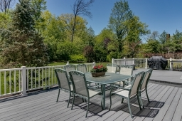 Expansive vinyl decking - opens to kitchen,family room and office!