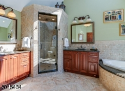 His & Hers vanities, jetted tub,glass enclosed shower with sunflower shower head and body sprays! Skylight!
