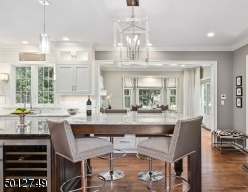Kitchen Opens to Breakfast Bar & Family Room