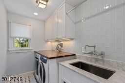 Walnut & Carrera Marble Counters & Glass Tile Backsplash. A Space to Truly Enjoy Doing Laundry