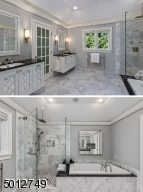 With Calacutta Marble, Radiant Heat Floors, Glass Shower w/ Rain Head, Air Jet Tub & TV Built into the Mirror