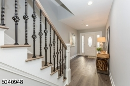 Custom decorative  railing with baluster and baskets.   Wide plank flooring