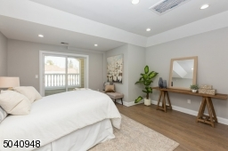 Retire to your master suite with private balcony, oversize walk-in closet Rich wide 4.5 inch wood oak flooring
