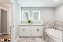 This bathroom will fit seamlessly into your lifestyle. Dual vanity, quartz  countertop, oval soaking tub.