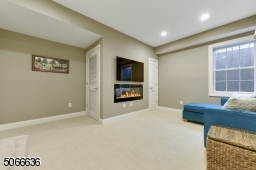 in finished basement with electric fireplace.