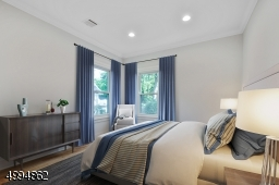 Quiet back bedroom with large double closet (virtually staged)