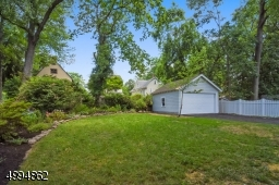 Meticulously landscaped backyard and 2-car detached garage