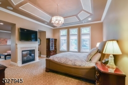 """17'8"""" x 15' Tray ceiling with detailed moulding, crown moulding, american brass & crystal chandelier, 2 sided fireplace with marble hearth and surround/custom wood mantle, wall mounted TV, Private Terrace overlooks pool"""