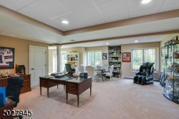 """22' x 20'3"""" Recessed lighting, wall to wall patterned carpet"""