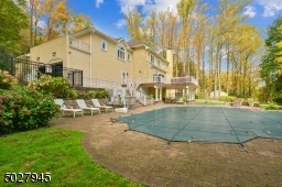 Landscape sprinkler system, heated gunite pool/custom designed by national pool/ 38,000 gallon/ paver decking