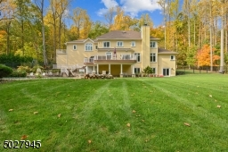 Secluded quietude on lushly landscaped 1.4 acres, 7 drywells in rear yard,