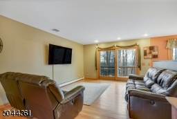 Large open space with hardwood flooring.