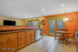 Large open kitchen, complete with SS appliances and a wine refrigerator.